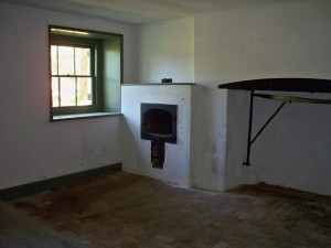The oven and stove fireplace in the ground level basement kitchen.
